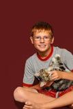 Jongen met Zijn Kat Royalty-vrije Stock Afbeelding