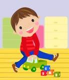Jongen met zijn stuk speelgoed Stock Foto's