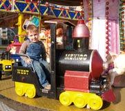 Jongen op carrousel Stock Afbeelding