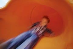 Jongen op dia in motie Stock Foto's