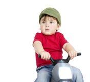 Jongen op een motorfiets. Stock Foto