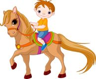 Jongen op paard Stock Fotografie