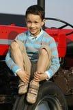 Jongen op tractor Royalty-vrije Stock Afbeelding