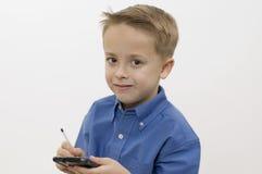 Jongen/palmtop/wit stock afbeeldingen