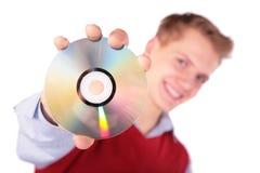 Jongen in rood jasje met CD Stock Fotografie