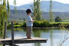 Jongen visserij Stock Foto
