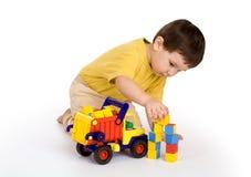 Jongen, vrachtwagen en blokken Stock Afbeeldingen