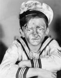 Jongen in zijn zeeliedenuitrusting met vuil gezicht (Alle afgeschilderde personen leven niet langer en geen landgoed bestaat Leve Stock Fotografie