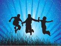 Jongens die met vreugde springen Stock Afbeelding