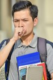 Jongensstudent Coughing royalty-vrije stock afbeelding