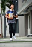 Jongensstudent And Happiness Walking royalty-vrije stock fotografie