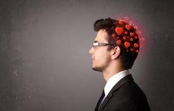 Jongere die over liefde met rode harten denken Stock Afbeelding