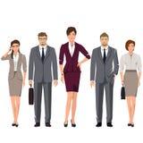 Jongeren in kostuums voor bureau Stock Foto