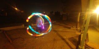 Jonglera ljusshow Fotografering för Bildbyråer