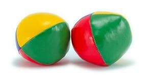 Jonglerend met ballen die op wit met schaduw worden geïsoleerdr Royalty-vrije Stock Foto's