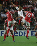 Jonny Wilkinson. Jump against two tonga's players during the qualification round of the Rugby World Cup 2007 between Tonga and England at the Parc des Prince on Royalty Free Stock Photos