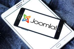 Joomla application logo. Logo of Joomla application on samsung mobile. Joomla! is a free and open-source content management system CMS for publishing web content royalty free stock photo