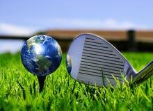 Jord - gilla en golfboll Arkivbild
