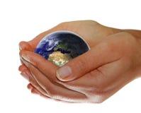 jord hands ditt Arkivfoto