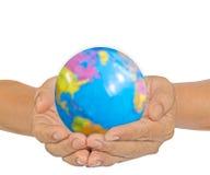 jord hands holdingen Royaltyfri Foto