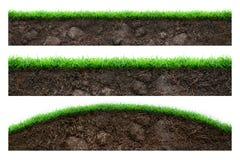 Jord och grönt gräs Fotografering för Bildbyråer