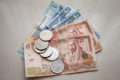 Jordańskich dinarów i piastrów monety zdjęcia stock