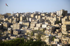 Jordan. Houses in Amman,Jordan with the flag in the background Stock Photo