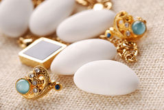 Jordan almonds and jewelry Royalty Free Stock Photography