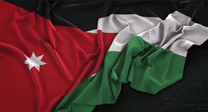 Jordan Flag Wrinkled On Dark-Hintergrund 3D übertragen Lizenzfreie Stockfotos