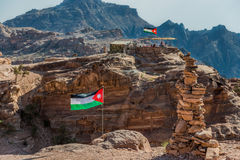 Jordan flags floating in nabatean city of  petra Stock Image