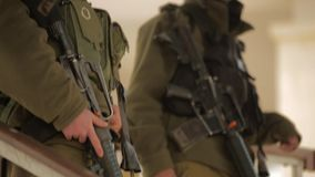 JORDAN, ISRAEL - FEBRUARY 13, 2015: An Israeli defense forces soldier dressed in uniform aims his M16 rifle. An Israeli defense forces soldier dressed in uniform stock video