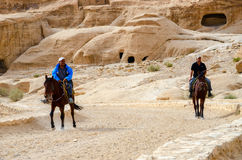 Jordan, Petra. Riders on the road in the canyon Stock Photography