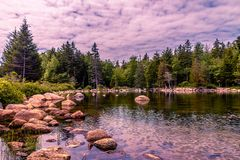 Jordan Pond - Acadia National Park in Maine. Jordan Pond is a glacier formed tarn with a maximum water depth of 150 feet 46 m. There are steep inclines on the Royalty Free Stock Photo