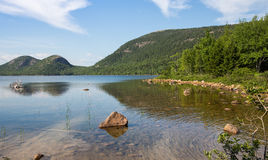 Jordan Pond Shoreline. This is a view of Jordan Pond in Acadia National Park. In the background are two mountains called the Bubbles Royalty Free Stock Photography