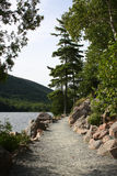 Jordan Pond Trail. Early evening view of a walking trail that circles Jordan Pond, Acadia National Park Stock Photos