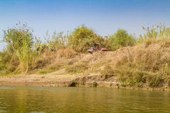 The Jordan River, all-terrain vehicle on top of the slope. Stock Image