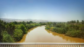Jordan River. That separate Israel and Jordan Stock Photo