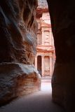 Jordan: Tomb in Petra. Tomb called Treasury seen from the opening of Siq, route to the ancient Nabatean city of Petra, Jordan royalty free stock image