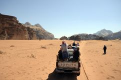 Jordan, Wadi Rum. Wadi Rum, Jordan - March 07, 2019: Unidentified tourists in pick-up car, usual mode of transport in the UNESCO World heritage site in Middle stock photo