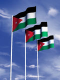 Jordanese flag. The flag of Jordan flying under a blue sky Royalty Free Stock Images