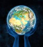 Jordanië op aarde in handen Stock Fotografie