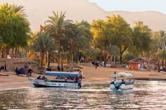 Jordanian boatmen waiting for tourists Stock Image