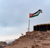 Jordanian flag. At desert scene. Edom mountains Royalty Free Stock Photos