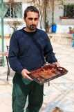 Jordanian man offering tea to the tourists visiting a local house Stock Images