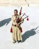 Jordanian man playing bagpipes Royalty Free Stock Image