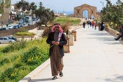 Jordanian man walking among the ruins of the city of Jerash Stock Photography