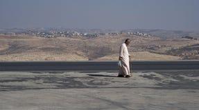 Jordanian senior man walking along road Royalty Free Stock Image