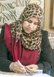 Jordanian woman working Royalty Free Stock Photos