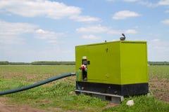 Jordbruks- diesel- pump och slang Royaltyfria Bilder
