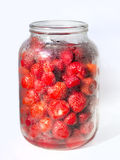 Jordgubbar i en stor glass krus Fotografering för Bildbyråer